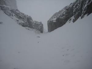 Number 5 Gully, Ben Nevis: Looking down through the narrrows below the upper snowfield. Photo: Chad Harrison