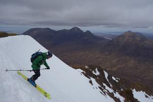 Glas Toll a' Bothain, Liathach: Glas-Toll a' Bothain: Dave Anderson setting off, with Beinn Alligin in the background. Photo: Scott Muir