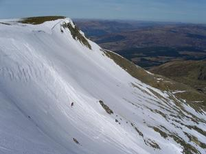 Summit Gully, Aonach Mor: Descending Summit Gully, with 'Spikes' in the background Photo: Scott Muir