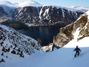 The Ruch Gruip, Loch Muick Basin: Skiiing in a fine position above Loch Muick. Photo: Scott Muir